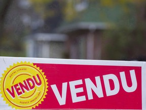 A sold sign is shown on the west island of Montreal, Saturday, November 4, 2017. Montreal was one of Canada's hottest real estate markets last year as low unemployment and economic growth translated into the area's best sales growth in a decade.