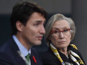 Minister of Crown-Indigenous Relations and Northern Affairs Carolyn Bennett listens as Prime Minister Justin Trudeau speaks at the Canada - Modern Treaty and Self-Governing First Nations Forum, in Ottawa on Wednesday, Nov. 1, 2017.
