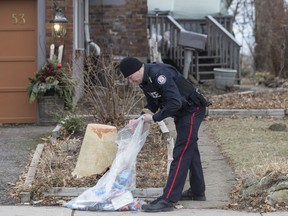 The discovery of dismembered skeletal remains in backyard planters and the police allegation that a serial killer is responsible for the gruesome crimes have prompted at least one homicide expert to suggest the perpetrator is likely a psychopath. A police officer is shown outside a house on Mallory Crescent in Toronto, where Bruce McArthur did landscape work, on Monday, January 29 , 2018. McArthur, 66, was charged Jan. 18 in the presumed deaths of five men.