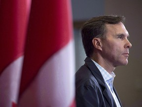 Finance Minister Bill Morneau takes questions as the Liberal cabinet meets in St. John's, N.L. on Tuesday, Sept. 12, 2017. The federal ethics commissioner has cleared Finance Minister Bill Morneau of insinuations that both he and his father benefited from insider information to save half a million dollars on the sale of shares in the family-built company.