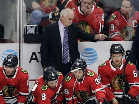 Chicago Blackhawks head coach Joel Quenneville points as he talks to his team during the first period of an NHL hockey game against the Edmonton Oilers, Sunday, Jan. 7, 2018, in Chicago.