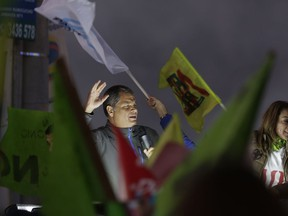 Ecuador's former President Rafael Correa leads a rally against an upcoming constitutional referendum in Rumicucho, Ecuador, Monday, Jan. 29, 2018. Sunday's referendum, called by current President Lenin Moreno, will present voters with seven questions, from making it impossible for Correa to run again for president, to lengthening the statute of limitations in cases of sexual abuse, to expanding national park territory to reduce oil drilling.