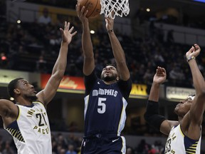 Memphis Grizzlies' Andrew Harrison (5) shoots against Indiana Pacers' Thaddeus Young, left, and Myles Turner during the first half of an NBA basketball game Wednesday, Jan. 31, 2018, in Indianapolis.