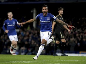Everton's Theo Walcott celebrates scoring his side's first goal of the game during their English Premier League soccer match against Leicester City at Goodison Park, Liverpool, England, Wednesday, Jan. 31, 2018.