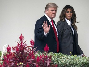 In this Wednesday, Oct. 11, 2017 file photo, President Donald Trump walks along the Colonnade with first lady Melania Trump on his way to board the Marine One helicopter on the South Lawn of the White House in Washington for a short trip to Andrews Air Force Base, Md., and then onto Harrisburg, Pa.