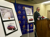 Det.-Sgt. Peter Thom of Hamilton police shows photos of the cars linked to last May's murder of mobster Angelo Musitano.