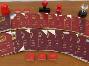 Sept. 15, 2015 Chinese passports and stamps seized by Canada Border Services Agency.