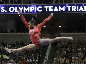 FILE - In this July 10, 2016, file photo, Simone Biles competes on the balance beam during the women's U.S. Olympic gymnastics trials in San Jose, Calif. Biles has met the new president of USA Gymnastics but hasn't heard from the U.S. Olympic Committee regarding the Larry Nassar sexual abuse scandal. The four-time gold medalist at the Rio Games is training for the 2020 Tokyo Olympics.