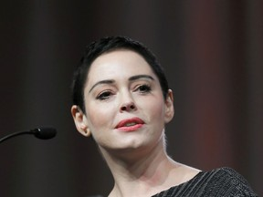 """FILE- In this Oct. 27, 2017, file photo, actress Rose McGowan speaks at the inaugural Women's Convention in Detroit. A lawyer for Harvey Weinstein called actress McGowan's claims of rape against the former Hollywood producer are """"a bold lie."""" McGowan details her allegations against Weinstein in her new book """"Brave,"""" released Tuesday, Jan. 30, 2018."""