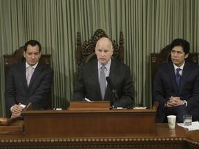 FILE - In this Jan. 24, 2017 file photo, California Gov. Jerry Brown delivers his annual State of the State address before a joint session of the California Legislature, in Sacramento, Calif. Brown will look back on his four terms as California's governor and lay out his vision for what's to come when he delivers his final State of the State address Thursday, Jan. 25, 2018. In the background are Assembly Speaker Anthony Rendon, D-Paramount, left, and Senate President Pro Tem Kevin de Leon, D-Los Angeles.