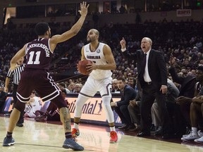 South Carolina guard Frank Booker (5) is defended by Mississippi State guard Quinndary Weatherspoon (11) during the first half of an NCAA college basketball game Wednesday,  Jan. 31, 2018, in Columbia, S.C.