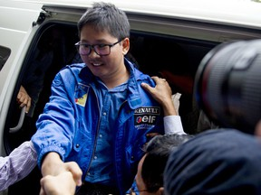 FILE - In this Dec. 27, 2017, file photo, Reuters journalist Thet Oo Maung, known as Wa Lone, exits a police van as he arrives for a court appearance, outside Yangon, Myanmar. Myanmar is set to put two reporters from the Reuters news agency on trial after they were charged under a colonial-era state secrets act, in a case that highlights growing concerns about press freedom in the country.