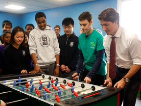 Prime Minister Justin Trudeau plays Foosball at the Dovercourt Boys and Girls Club in Toronto before announcing a doubling of the Canada Summer Jobs program on Feb. 12, 2016.