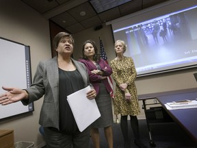 FILE - In this Feb. 16, 2017 file photo, El Paso County Attorney Jo Anne Bernal, left, answers a question in El Paso, Texas, as County Judge Veronica Escobar and Center Against Sexual and Family Violence Executive Director Stephanie Karr listen as the three take questions from local media concerning the arrest of Irvin Gonzalez at a courthouse. The transgender woman was obtaining a protective order against an abusive boyfriend when she was detained, drawing national attention to the issue of courthouse arrests by immigration agents. Federal immigration authorities announced Wednesday, Jan. 31, 2017 that agents will enter courthouses only to capture specific targets, like convicted criminals, gang members, public safety threats and immigrants who have been previously deported or ordered to leave.