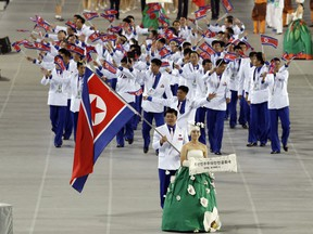 FILE - In this Sept. 19, 2014, file photo. athletes from North Korea march into the stadium during the opening ceremony for the 17th Asian Games in Incheon, South Korea. North Korea attended the Asian Games in Incheon, South Korea. At the close of the event, three top North Korean officials made a surprise visit and held the highest-level face-to-face talks with South Korea in five years.
