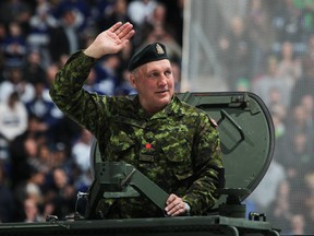 "Retired Toronto Maple Leafs player Dave ""Tiger"" Williams salutes the crowd on military honour night prior to a game between the Winnipeg Jets and the Toronto Maple Leafs on March 16, 2013 at the Air Canada Centre in Toronto, Ontario, Canada."