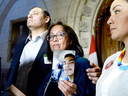 Debbie Baptiste holds a photo of her son Colten Boushie, as the family spoke to reporters in the House of Commons after a day of meetings on Parliament Hill, Feb. 13, 2018.