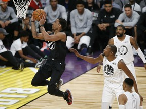 DeMar DeRozan of the Toronto Raptors goes hard to the basket for an easy layup on behalf of Team Stephen during Sunday's NBA All-Star Classic in Los Angeles. Despite 21 points by DeRozan, the team labelled Team LeBron pulled out an exciting 148-145 victory.