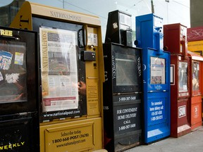 Newspaper boxes are seen on a street in Toronto in a photo taken April 17, 2009.