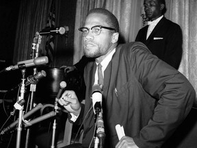 "FILE - In this Feb. 13, 1963 file photo, Nation of Islam leader Malcolm X speaks to the press in New York as Muslims were picketing through the Times Square area. A Smithsonian Channel series, ""The Lost Tapes: Malcolm X,"" examining the life of civil right leader Malcolm X, follows the advocate's changing philosophy using his own words as a Nation of Islam surrogate to a figure seeking to build coalitions during the tumultuous 1960s civil rights era."