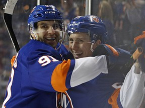 New York Islanders center John Tavares (91) celebrates with teammate Tanner Fritz (56) after Fritz scored his first career NHL goal during the second period of an NHL hockey game against the Minnesota Wild in New York, Monday, Feb. 19, 2018.
