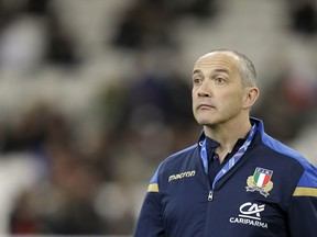 Italy's rugby coach Conor O'Shea watches his players during the warm up prior to the start of the Six Nations rugby union match between France and Italy at the Velodrome stadium in Marseille, southern France, Saturday, Feb. 23, 2018.