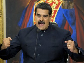 FILE - In this Oct. 17, 2017 file photo, Venezuela's President Nicolas Maduro gives a press conference at Miraflores presidential palace in Caracas, Venezuela. Cash-strapped Venezuela on Tuesday, Feb. 20, 2108 became the first country to launch its own version of bitcoin, a move Maduro celebrated as putting his country on the world's technological forefront.