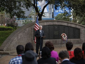 U.S. Secretary of State Rex Tillerson speaks to survivors, seated in foreground, after laying a wreath during a ceremony at Memorial Park in honor of the victims of the deadly 1998 U.S. Embassy bombing, in Nairobi, Kenya, Sunday, March 11, 2018.  In 1998 the US embassies were bombed in near simultaneous attacks in two East African cities, in which over 200 people were killed.