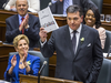 Ontario Finance Minister Charles Sousa delivers the provincial budget while Premier Kathleen Wynne applauds, March 28, 2018.