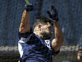 San Diego Padres first baseman Eric Hosmer swings away during batting practice before an opening day baseball game against the Milwaukee Brewers in San Diego, Thursday, March 29, 2018.