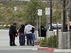 Family members and friends of Perla Morales Luna gather in front of the Otay Mesa Detention Center Tuesday, March 20, 2018, in San Diego. Morales Luna, a Mexican woman whose videotaped arrest for being in the U.S. illegally gained widespread attention online is being released on her own recognizance by an immigration judge in Southern California.