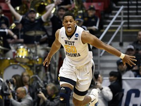 West Virginia forward Sagaba Konate (50) reacts after scoring during the second half of a second-round NCAA college basketball tournament game against Marshall, Sunday, March 18, 2018, in San Diego. West Virginia defeated Marshall 94-71.