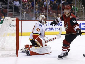 Max Domi of the Arizona Coyotes scores against Calgary Flames' goaltender Mike Smith during NHL action Monday night in Glendale, Az. The Coyotes were 5-2 winners, seriously damaging the Flames' hopes of securing a playoff position in the West Conference with eight games remaining on the schedule.