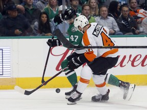 Dallas Stars right wing Alexander Radulov (47) battles Philadelphia Flyers defenseman Andrew MacDonald (47) for the puck during the first period of an NHL hockey game in Dallas, Tuesday, March. 27, 2018.