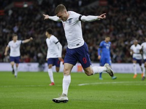 England's Jamie Vardy celebrates after scoring his side's opening goal during the international friendly soccer match between England and Italy at the Wembley Stadium in London, Tuesday, March 27, 2018.