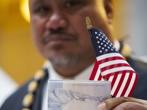 In this undated image provided by nonprofit advocacy and legal group Equally American, John Fitisemanu, an American Samoan and the lead plaintiff in a lawsuit against the United States seeking full U.S. citizenship, poses for a photo in Salt Lake City, Utah. A lawsuit filed Tuesday, March 27, 2018, in federal court in Utah seeks to grant U.S. citizenship status to American Samoans. John Fitisemanu, and others who were born in American Samoa, are asking the court for citizenship under the 14th Amendment of the Constitution, which confers citizenship at birth to anyone born in the U.S.
