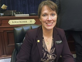 """In this Thursday, March 1, 2018 photo, Idaho Republican state Rep. Priscilla Giddings sits at the Capitol in Boise. The Idaho lawmaker urges her constituents to send in submissions for her """"fake news awards"""" during the legislative session. Officials at all levels of government are now using the term """"fake news"""" as a weapon against unflattering stories and information that can tarnish their images. Experts on the press and democracy say the cries of """"fake news"""" could do long-term damage by sowing confusion and contempt for journalists, and by undermining the media's role as a watchdog on government and politicians."""