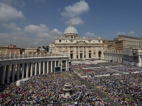 FILE - This Wednesday, June 5, 2013 file photo shows a general view of the crowd in St. Peter's Square during Pope Francis general audience, at the Vatican.The Vatican's crackdown on the commercial use of its official emblems has found resistance from a Spanish website that refuses to give up on referencing the seat of the Catholic Church in its masthead. Spain's trademark office said in September 2017 that InfoVaticana.com, a privately-run website that publishes articles about religion in Spanish and Italian, can't register as a brand because that would mislead readers about being officially tied to the Holy See.