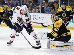Boston Bruins' Tuukka Rask (40), of Finland, blocks a shot by Chicago Blackhawks' Matthew Highmore (36) during the first period of an NHL hockey game in Boston, Saturday, March 10, 2018.