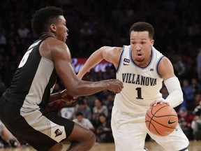 Villanova's Jalen Brunson (1) drives past Providence's Rodney Bullock (5) during the first half of an NCAA college basketball game in the Big East men's tournament final Saturday, March 10, 2018, in New York.