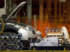 American trade officials are showing newfound interest in a Canadian proposal for revamping NAFTA's automotive provisions as the U.S. seeks to swiftly conclude renegotiations of the continental free trade pact. A line worker works on a car at Ford Motor plant in Oakville, Ont., on Friday, January 4, 2013.