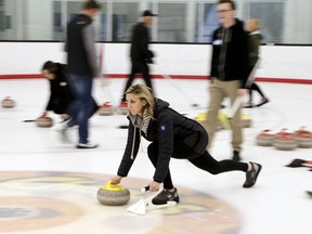 In this March 4, 2018 photo, participants in an all-ages group learn how to curl at the Aksarben Curling Club in Omaha, Neb. Curling clubs across the United States have seen a major uptick in interest in the sport in the wake of the U.S. men winning the gold medal at the Winter Olympics. The Aksarben Curling Club in Omaha reports that 1,000 people will participate in its learn-to-curl events this winter and spring. That is more than twice as many as in a normal year.
