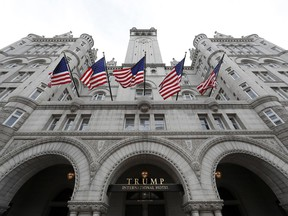 FILE - This Dec. 21, 2016 file photo shows the Trump International Hotel at 1100 Pennsylvania Avenue NW,  in Washington. A federal judge Wednesday, March 28, 2018 allowed Maryland and the District of Columbia to proceed with their lawsuit accusing President Donald Trump of accepting unconstitutional gifts from foreign interests, but limited the case to the president's involvement with the Trump International Hotel in Washington. U.S. District Judge Peter J. Messitte's ruling dismissed other sections of the lawsuit that raised concerns about the impact of foreign gifts to the president from Trump Organization properties outside of Washington.