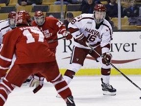 FILE- In this Feb. 5, 2018, file photo, Harvard forward Ryan Donato (16) looks to pass against Boston University during the second period of the first round of the Beanpot hockey tournament in Boston. The Boston Bruins have signed Donato to a two-year entry-level deal and say the U.S. Olympic star could play as soon as Monday, March 19, 2018.