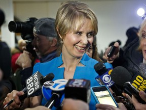 Candidate for New York governor Cynthia Nixon speaks with reporters at her first campaign stop, Tuesday March 20, 2018, in the Brownsville section of Brooklyn, in New York. Nixon will challenge New York Gov. Andrew Cuomo for the Democratic nomination.