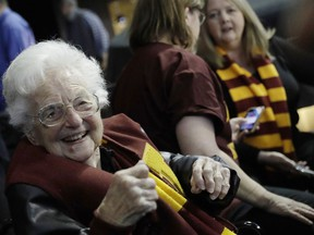 FILE - This March 22, 2018 file photo shows Sister Jean Dolores Schmidt sitting with other Loyola-Chicago fans during the first half of a regional semifinal NCAA college basketball game against Nevada in Atlanta. Sister Jean is depicted in a bobblehead and sales of the figurine have soared to the heavens. She has become a celebrity during the NCAA men's basketball tournament. As a result, the National Bobblehead Hall of Fame and Museum, in conjunction with Loyola University, last week unveiled a limited edition bobblehead. Phil Sklar with the soon-to-be-open museum in Milwaukee says within 24 hours, the bobblehead became the institution's top seller of all time.