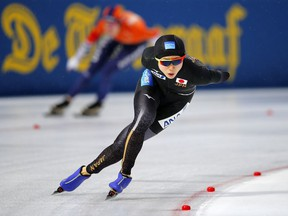 Miho Takagi of Japan competes against Ireen Wust of The Netherlands, rear, during the women's 1,500 meters race at the World Championships Speedskating Allround at the Olympic stadium in Amsterdam, Netherlands, Saturday, March 10, 2018.
