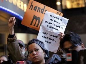 FILE - In this Jan. 16, 2018, file photo, supporters look on as Maru Mora-Villalpando speaks at a news conference in Seattle announcing that the longtime activist for illegal immigrants in the Northwest says she herself is now facing deportation. A federal judge in Seattle has opened the door for thousands of immigrants to apply for asylum, finding that the Department of Homeland Security has routinely failed to notify them of a deadline for filing their applications.