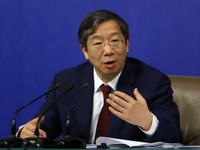 FILE - In this March 9, 2018, file photo, Yi Gang, vice governor governor of the People's Bank of China, speaks during a press conference held on the sidelines of the annual meeting of China's National People's Congress (NPC) in Beijing. Yi outlined sweeping plans Sunday, March 25, 2018 to rein in rising debt and financial risk, but expressed confidence that Beijing can prevent potential dangers.