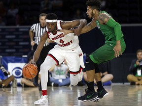 Western Kentucky guard Josh Anderson (4) tries to get past Marshall guard Rondale Watson (23) during the first half of the Conference USA Men's Basketball Championship Game in Frisco, Texas, Saturday, March 10, 2018.